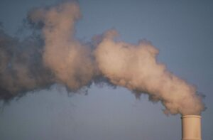 air pollution smoke rising from plant tower scaled 1